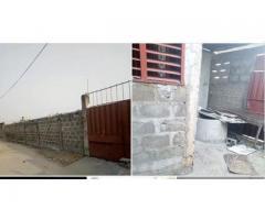 en vente une parcelle clôturée en angle de rue au quartier Aibatin