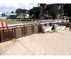 Un hectare 4 parcelles une villa piscine clôturé au bord des pavés à Godomey togoudo