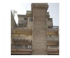 en vente un géant immeuble r+3 a vendre a zogbo avec titre foncier.